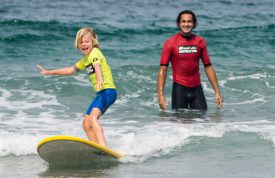 Learning to surf at The Watersports Camp