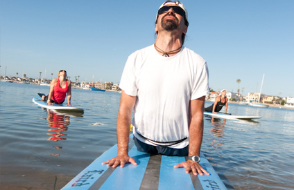 Stand up paddle yoga students