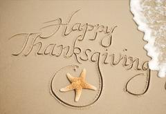 Happy Thanksgiving written in sand